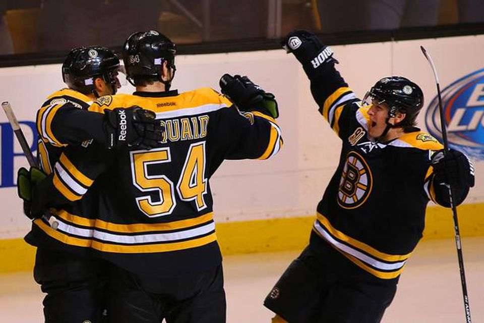 Torey Krug (right) celebrated with Patrice Bergeron (left) and Adam McQuaid after Bergeron's goal in the third period.