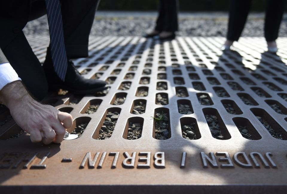 A member of the World Jewish Congress lights a candle at the Gleis 17 (Track 17) memorial of the deportation of Jews from Berlin to concentration camps during World War II, in Berlin Sept. 16.