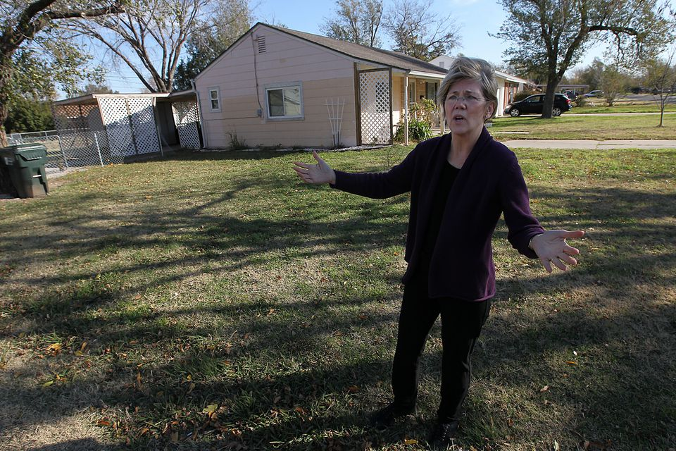 Elizabeth Warren, outside her childhood home in Norman, Okla., last year. She said her parents had to elope because her father's family disapproved of her mother's Native American ancestry.
