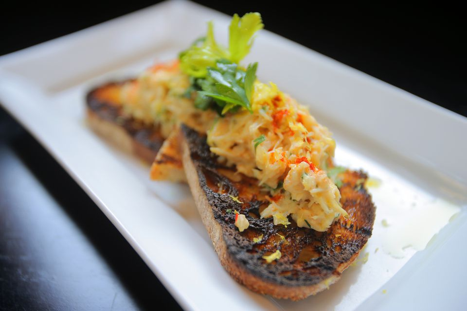 Boston, MA - 02/12/14 - Dining Out review of Row 34 in Fort Point. Deviled crab toast with smoked paprika and celery salad. Lane Turner/Globe Staff Section: FOOD Reporter: Devra First Slug: 19dinpic