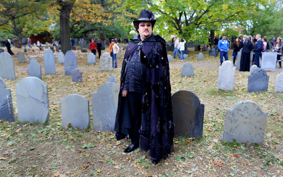 """Christian Day, shown in his work clothes, promotes himself as """"the World's Best-Known Warlock."""""""
