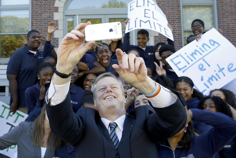 """Governor Baker took a """"selfie"""" with Brooke Charter School students Thursday in Boston."""