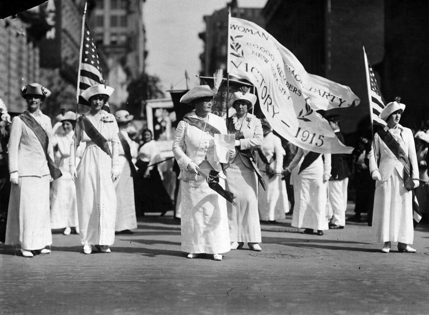 1915: From left to right, Mrs James Leeds Laidlaw, Mrs Albert Plimpton, Mrs A Hughston, Mrs Frank Stratton and Helen Rich lead the Manhattan Delegation on a Woman Suffrage Party parade through New York.